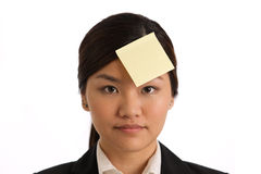 Business woman with a blank post-it note on head Stock Images