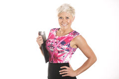 Business Woman. Blonde business woman in studio holding clipboard Stock Photo