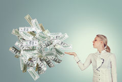 Business woman blowing a bunch of dollars royalty free stock photos