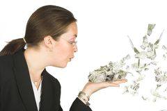 Business woman blowing dollars Stock Images