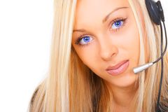 The business woman with blue eyes. The girl the operator with blue eyes Stock Photos