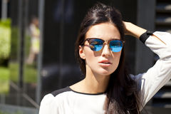 Business woman with blue mirrored sunglasses Royalty Free Stock Photo