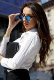 Business woman with blue mirrored sunglasses Stock Photo