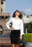 Business woman with blue mirrored sunglasses Royalty Free Stock Image