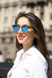 Business woman with blue mirrored sunglasses Stock Images