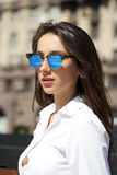 Business woman with blue mirrored sunglasses Stock Photography