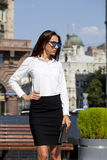 Business woman with blue mirrored sunglasses Royalty Free Stock Photography