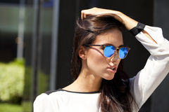 Business woman with blue mirrored sunglasses Stock Photos