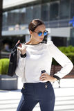 Business woman with blue mirrored sunglasses Stock Image