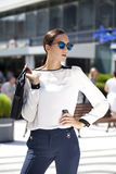 Business woman with blue mirrored sunglasses Royalty Free Stock Images