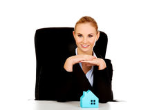 Business woman with blue paper house on the desk Royalty Free Stock Photo