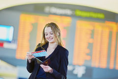 Business woman with boarding pass and passport in international airport Stock Photo