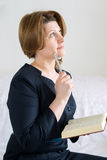 Business woman with book and pen in hand Royalty Free Stock Photography