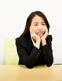 Business woman bored. Thai business woman bored of her work Stock Photography