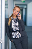 Business woman bored on the phone Stock Photos