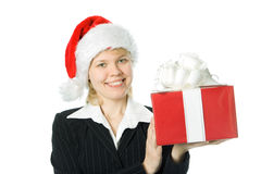 Business woman with box gift. In red santa hat over white background Royalty Free Stock Image