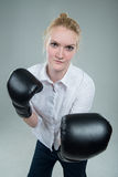 Business woman in box gloves ready to fight. Concept of competition, strength and defense royalty free stock images
