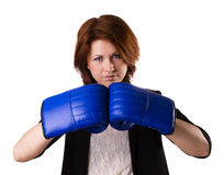 Business woman boxing. Businesswoman in suit punching with red boxing gloves isolated on white background Royalty Free Stock Photos