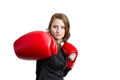 Business woman with a boxing glove Royalty Free Stock Photos