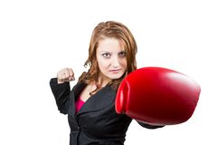 Business woman with a boxing glove Royalty Free Stock Images