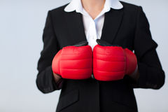 Business woman with boxing gloves on Royalty Free Stock Photos