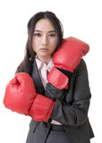 Business woman with boxing gloves Stock Photo