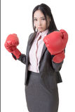 Business woman with boxing gloves Royalty Free Stock Image