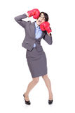 Business woman boxing and knock down itself. Funny businesswoman wearing boxing gloves and knock down itself, defeated loser woman - business concept - hopeless royalty free stock photo