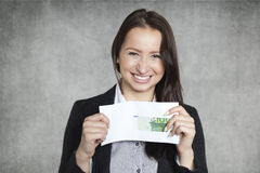 Business woman with a bribe Stock Image