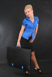 Business woman with a briefcase. Successful business woman with a briefcase, on black background stock photography