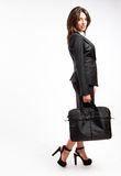 Business woman with briefcase. Full body portrait of business woman walking with briefcase on white background Stock Images
