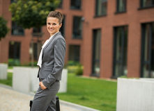 Business woman with briefcase in front of office Stock Photography