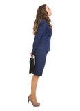 Business woman with briefcase look out for something Royalty Free Stock Images