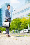 Business woman with briefcase in office district Stock Photography