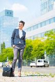 Business woman with briefcase in office district Royalty Free Stock Images