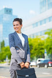 Business woman with briefcase in office district looking aside Stock Photography