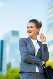 Business woman with briefcase in office district Royalty Free Stock Image