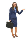 Business woman with briefcase presenting something on empty palm Royalty Free Stock Photo