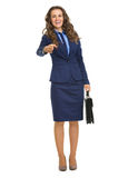 Business woman with briefcase stretching hand for handshake Stock Photos
