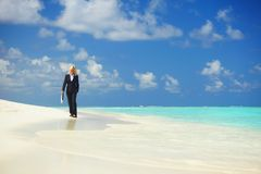 Business woman on the ocean coast Royalty Free Stock Images