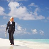 Business woman on the ocean coast Stock Photography