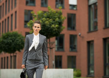 Business woman with briefcase walking in office Stock Photography
