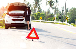 Business woman with a broken car Royalty Free Stock Image