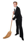 Business woman with broom Royalty Free Stock Photos
