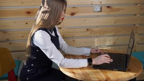 Business woman browsing news on laptop on her hand smart watch for checking mail stock video footage
