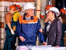 Business woman in builder helmet Stock Photography