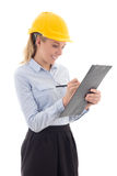 Business woman in builder helmet writing something in clipboard Stock Photography
