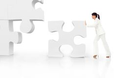 Business woman building a puzzle Royalty Free Stock Image