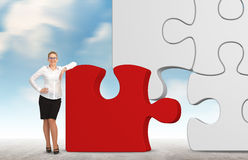 Business woman building a puzzle on a sky background. Stock Images
