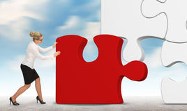 Business woman building a puzzle on a sky background Stock Photography